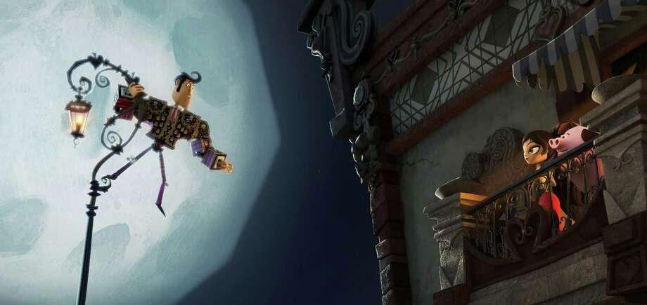 "Manolo (Diego Luna) woos Maria (Zoë Saldana) in a the Mexican folklore animated movie ""The Book of Life."" Photo: Associated Press / Twentieth Century Fox"