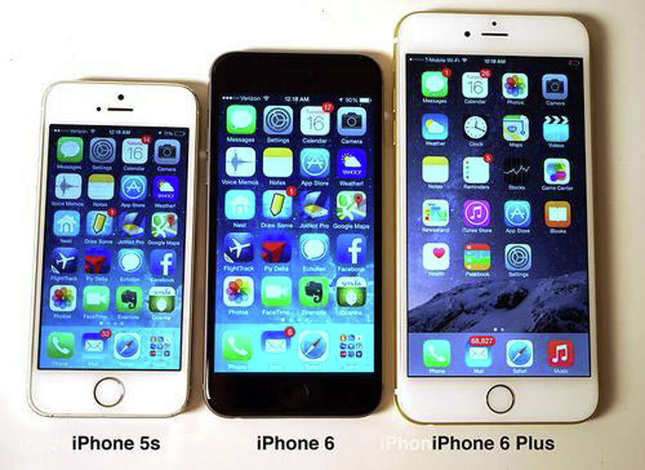 Apple's iPhone 5, iPhone 6 and mega-sized iPhone 6 Plus. Photo: Westport News/Contributed Photo / Westport News