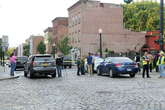 Police block off South Pearl Street between Schuyler and Bassett Streets as officers investigate a shooting of a male victim there on Thursday, Oct. 16, 2014 in Albany, N.Y.  (Lori Van Buren / Times Union) Photo: Lori Van Buren