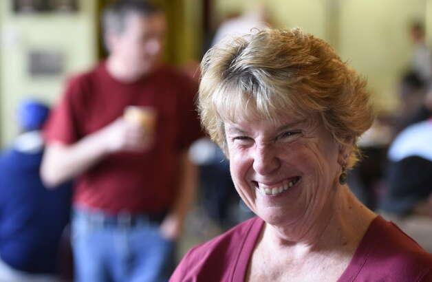 Barbara Quinn is all smiles as she runs the St. John's/St. Ann's Outreach Center Welcome Table Tuesday. (Skip Dickstein/Times Union)