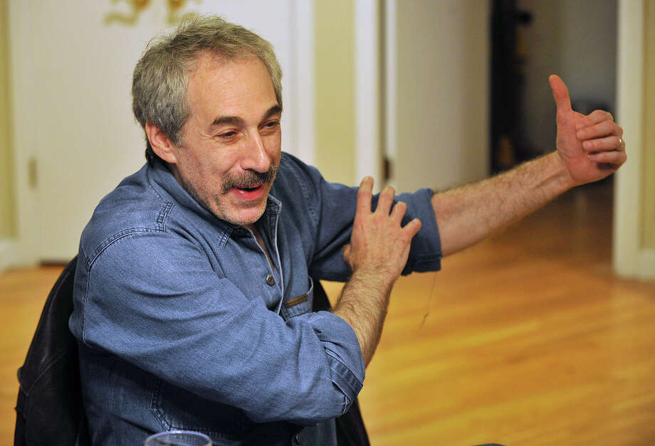 Alan Weiss describes being grabbed by a hospital security guard while sitting at his dining room table at his home in Stamford, Conn., on Wednesday, Oct. 15, 2014. Weiss, a former television news producer for WABC, was a patient in Roosevelt Hospital in New York City when police brought in gun-shot victim John Lennon. Weiss was allegedly the first to break the news of the death of John Lennon. Photo: Jason Rearick / Stamford Advocate