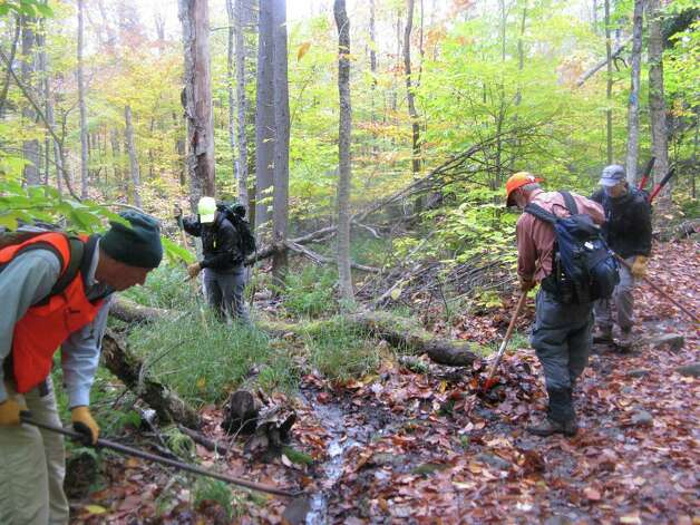 Members of the Adirondack Mountain Club clear leaves from a water bar on the Northville-Placid Trail during a recent volunteer outing. (Gillian Scott / Times Union)