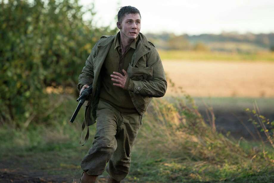 "Logan Lerman stars as green gunner/narrator Norman Ellison in ""Fury."" Photo: Giles Keyte, HONS / Sony Pictures Entertainment"