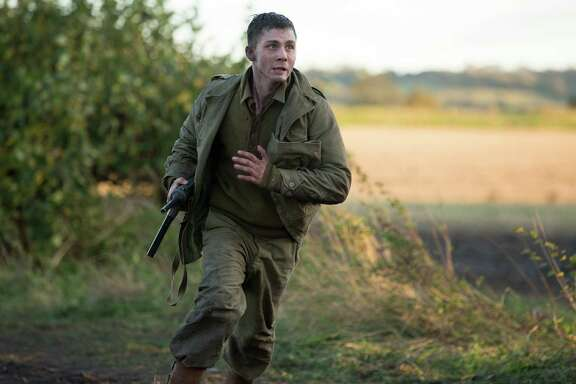 "Logan Lerman stars as green gunner/narrator Norman Ellison in ""Fury."""