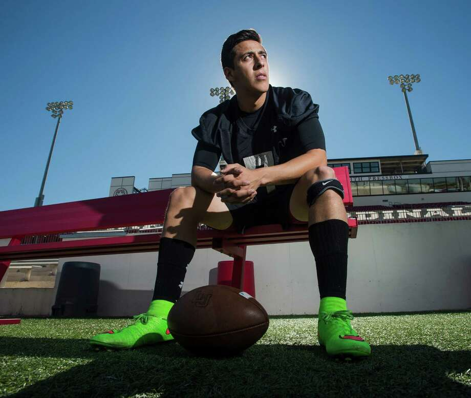 Juan Carranco poses for a photo at Provost Umphrey Stadium before practice Tuesday afternoon. Carranco punts and kicks for the Lamar Cardinals. He sports brightly colored soccer cleats when he takes the field. Photo taken Tuesday 10/14/14 Jake Daniels/@JakeD_in_SETX Photo: Jake Daniels / ©2014 The Beaumont Enterprise/Jake Daniels