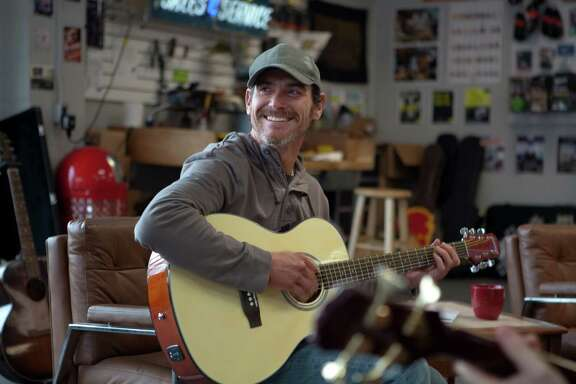 """Sam (Billy Crudup) finds comfort in music following his son's death in """"Rudderless."""""""