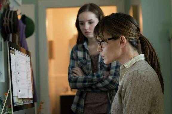 "Patricia (Jennifer Garner, right) checks daughter Brandy's (Kaitlyn Dever) social-media interactions in  ""Men, Women & Children."""