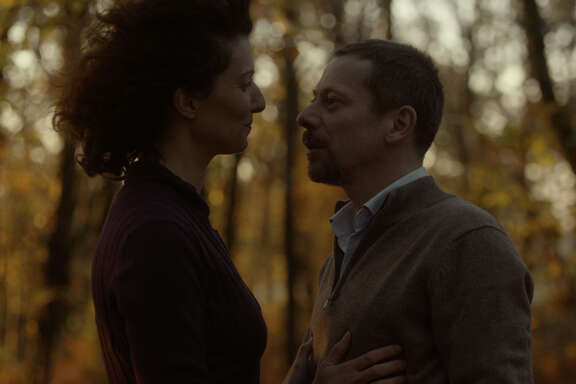 """A married man (Mathieu Amalric,  right) has an affair with a married woman (Stéphanie Cléau) in """"The Blue Room"""""""