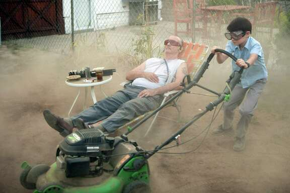 """Vincent (Bill Murray, left) takes a lax approach to baby-sitting Oliver (Jaeden Lieberher) in """"St. Vincent."""""""