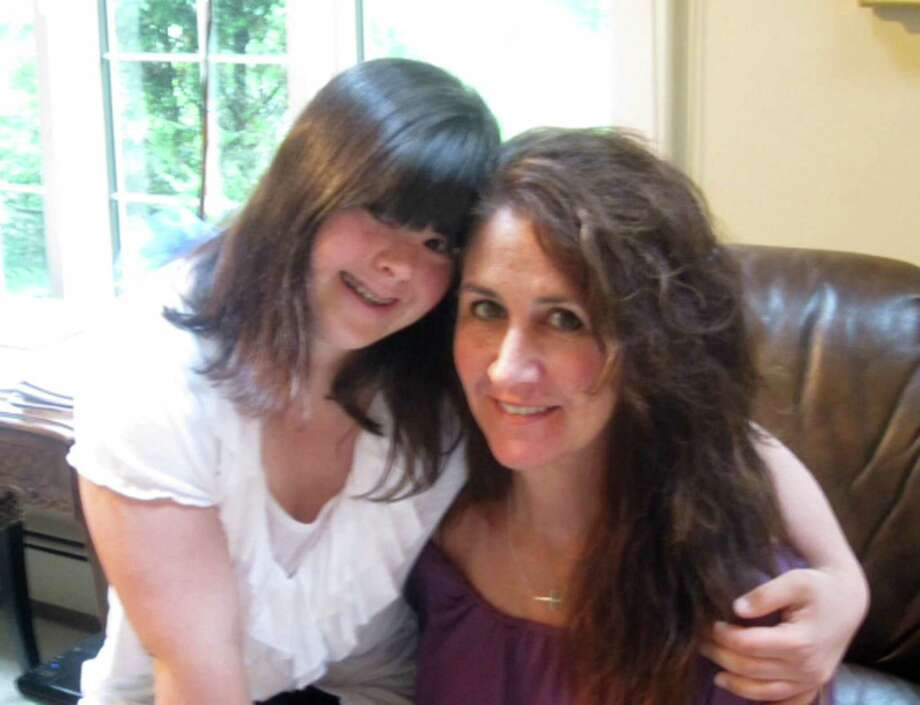 Rosemary Alfredo is pictured with her 24-year-old daughter Collette DiVitto.  Alfredo is fighting a court  order to Collette to Connecticut from Massachusetts because Collette's court-appointed guardian has determined she's better off living her father. Photo: Contributed Photo / The News-Times Contributed