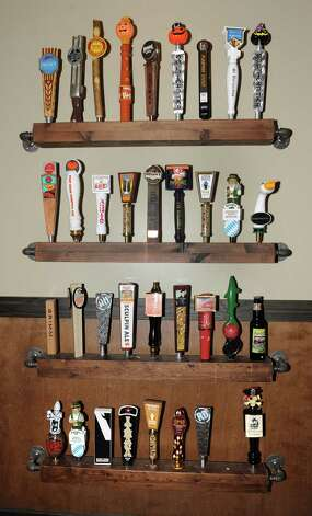 Display of beer taps are seen on a wall at World of Beer at Crossgates Mall on Friday, Oct. 10, 2014 in Guilderland, N.Y. (Lori Van Buren / Times Union) Photo: Lori Van Buren / 10028965A