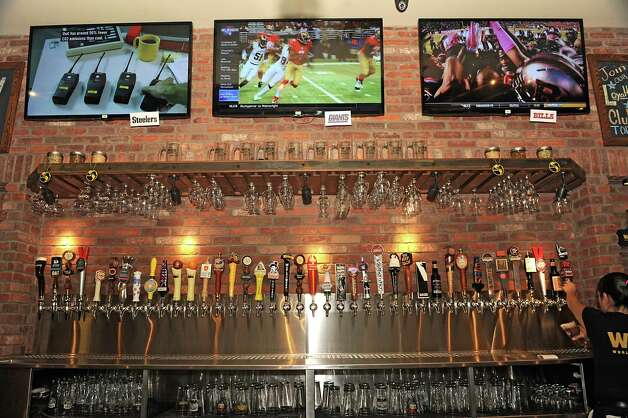 A large variety of beer taps are seen behind the bar at World of Beer at Crossgates Mall on Friday, Oct. 10, 2014 in Guilderland, N.Y. (Lori Van Buren / Times Union) Photo: Lori Van Buren / 10028965A
