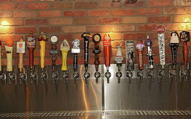 Detail of a large variety of beer taps seen behind the bar at World of Beer at Crossgates Mall on Friday, Oct. 10, 2014 in Guilderland, N.Y. (Lori Van Buren / Times Union) Photo: Lori Van Buren / 10028965A