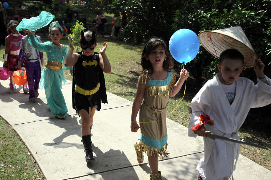 A costume parade for children is part of the fun during BOOtanica! at the San Antonio Botanical Garden. Photo: JENNIFER WHITNEY,  Freelancer / For The Express-News / San Antonio Express-News