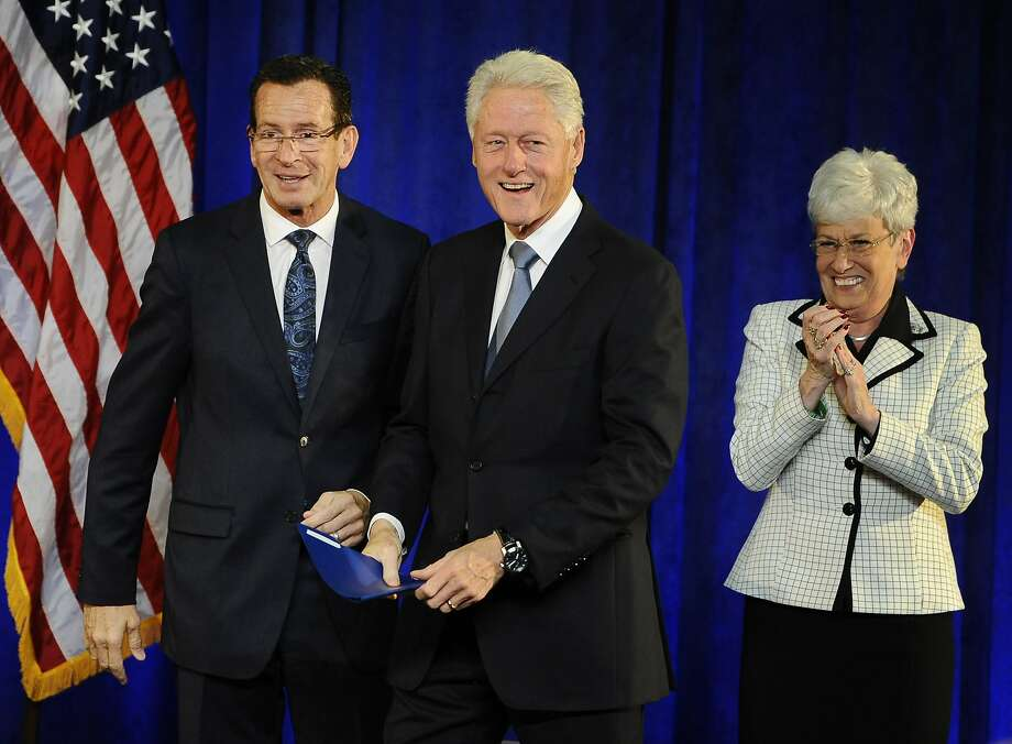 Gov. Dannel P. Malloy, left, greets former President Bill Clinton, center, as Lt. Gov. Nancy Wyman looks on, at a rally, Monday, Oct. 13, 2014, in Hartford, Conn.  (AP Photo/Jessica Hill) Photo: Jessica Hill, Associated Press