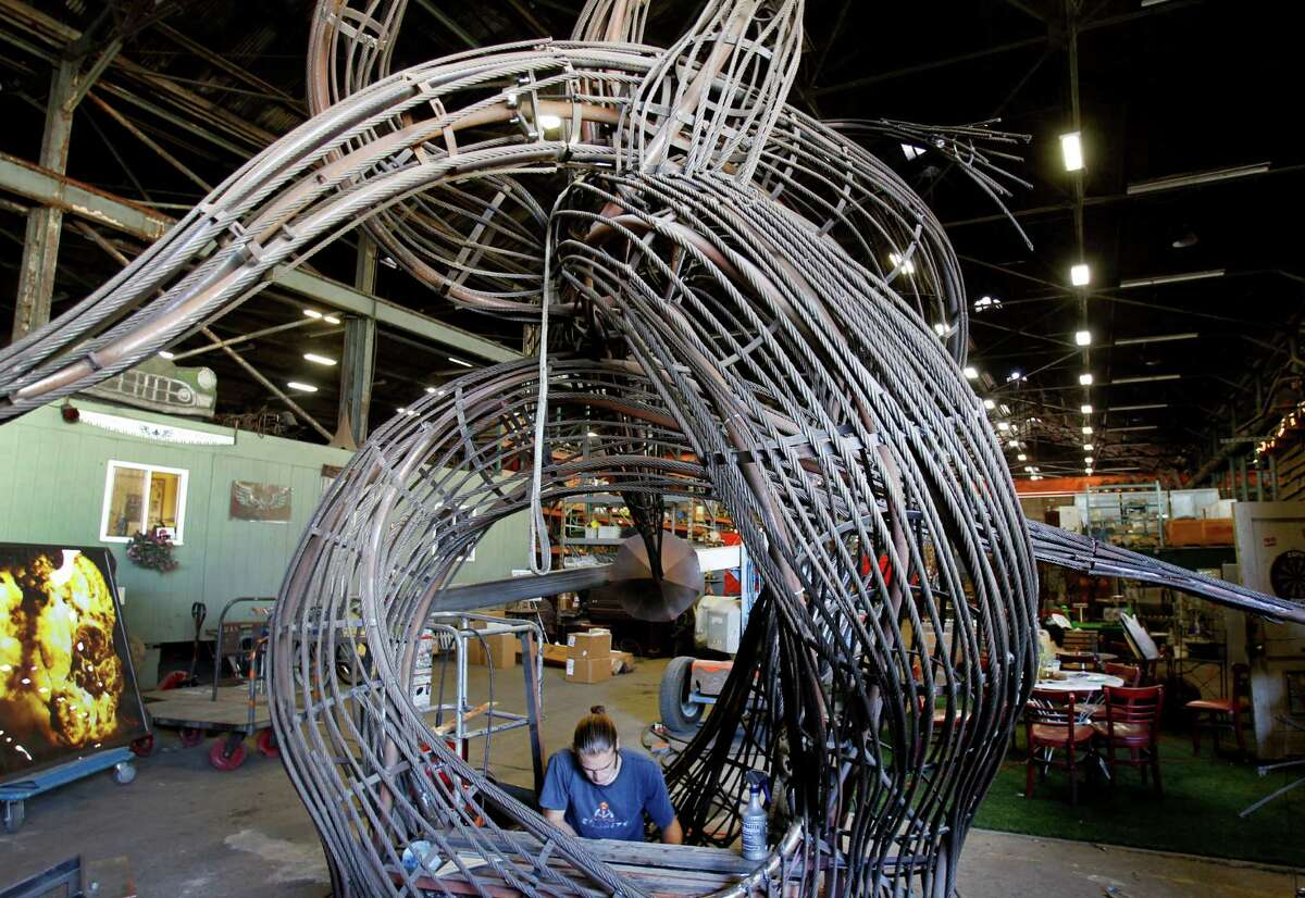 A sculptor puts finishing touches on a design at American Steel Studios on Mandela Parkway. The area was home to the Cypress Structure, which collapsed in the Loma Prieta earthquake in 1989.