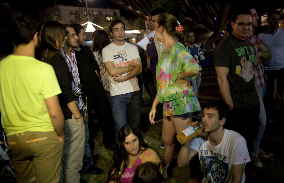 Young Israelis attend a gathering encouraging others to immigrate to Berlin in Tel Aviv, Israel. Photo: Ariel Schalit / Associated Press / AP