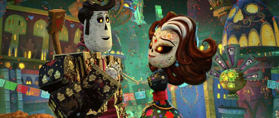 """This image released by Twentieth Century Fox  shows the characters Manolo, voiced by Diego Luna, left, and Carmen Sanchez, voiced by Ana de la Reguera  in a scene from """"The Book of Life.""""  (AP Photo/Twentieth Century Fox) ORG XMIT: NYET142 Photo: Twentieth Century Fox & Reel FX / Twentieth Century Fox"""