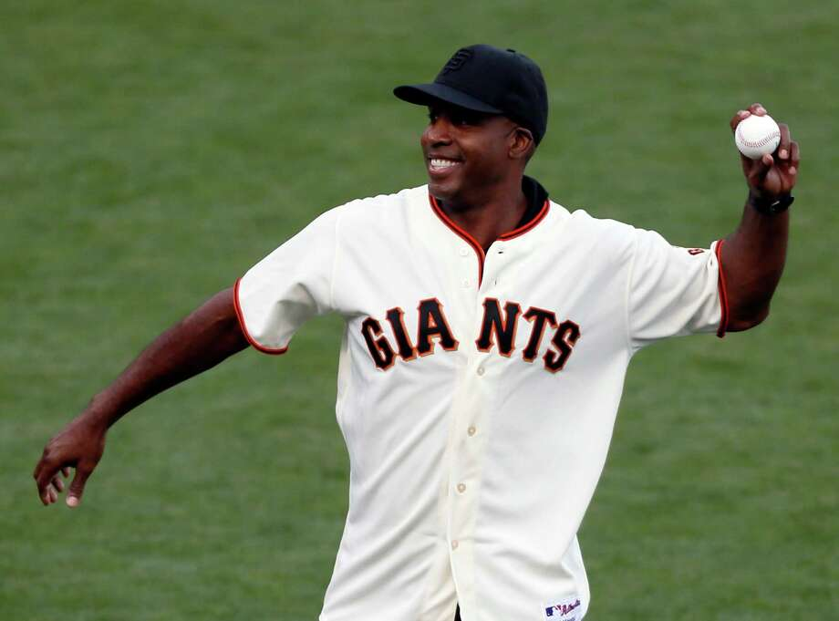Former Giants player Barry Bonds throws the ceremonial first pitch during Game 4 of the NLCS at AT&T Park on Wednesday, Oct. 15, 2014 in San Francisco, Calif. Photo: Beck Diefenbach / Special To The Chronicle / ONLINE_YES