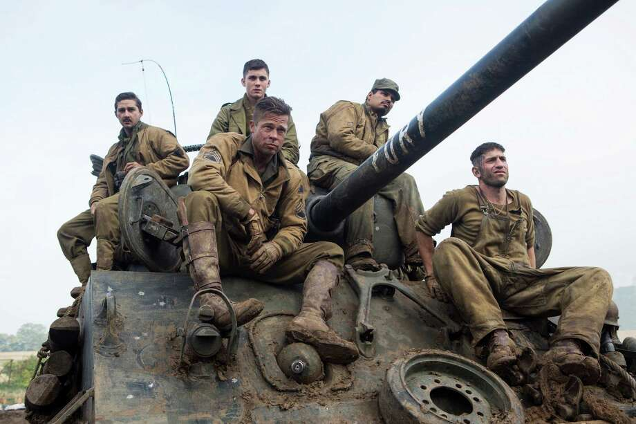"This photo released by Sony Pictures Entertainment shows, from left, Shia LaBeouf as Boyd ""Bible"" Swan, Logan Lerman as Norman, Brad Pitt as Sgt. Don ""Wardaddy"" Collier, Michael Pena as Trini ""Gordo"" Garcia, and Jon Bernthal as Grady ""Coon-Ass"" Travis, in Columbia Pictures' ""Fury."" Before the World War II tank drama reaches theaters Oct. 17, gamers can make like Pitt's character and steer a virtual rendition of the M4A3E8 Sherman tank he commands in the film in the game ""World of Tanks."" It's the latest example of a likeminded movie and game aligning to hype each other, and it marks the first Hollywood pact for the popular online tank combat title. (AP Photo/Sony Pictures Entertainment, Giles Keyte) ORG XMIT: CAET942 Photo: Giles Keyte / Sony Pictures Entertainment"