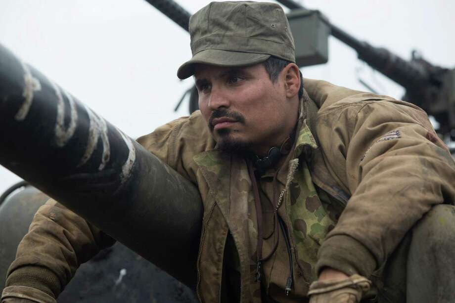 "This photo released by Sony Pictures Entertainment shows Michael Pena, as Trini ""Gordo"" Garcia, in a scene from Columbia Pictures' ""Fury."" (AP Photo/Sony Pictures Entertainment, Giles Keyte) ORG XMIT: CAET949 Photo: Giles Keyte / Sony Pictures Entertainment"