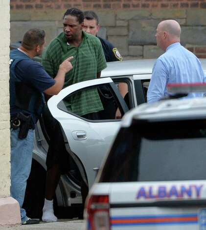 """A suspect identified only by his street name """"six seven"""" is taken in to custody by the Albany police after a multi-hour search Thursday afternoon Oct. 16, 2014 in Albany, N.Y.     (Skip Dickstein/Times Union) Photo: SKIP DICKSTEIN"""