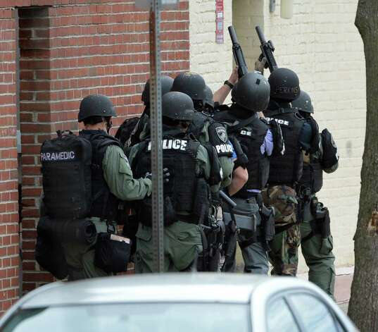 The Albany Police emergency response team prepares to breech a door at 70 Basset Street  Thursday afternoon Oct. 16, 2014 in Albany, N.Y.     (Skip Dickstein/Times Union) Photo: SKIP DICKSTEIN