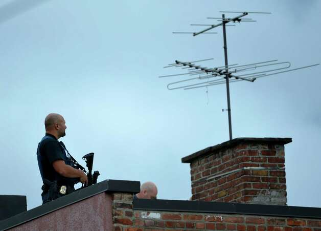 The Albany Police keep a look out for a shooting suspect  above 70 Basset Street  Thursday afternoon Oct. 16, 2014 in Albany, N.Y.     (Skip Dickstein/Times Union) Photo: SKIP DICKSTEIN