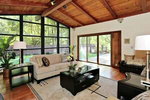 Like the dining room, the family room opens to the level backyard through a sliding glass door.