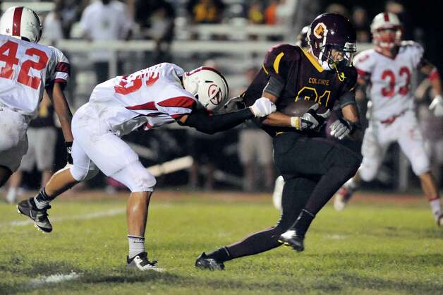Colonie's Eugene Reyes runs for the end zone as Guilderland's Sean Murphy defends during their football game on Friday, Sept. 5, 2014, at Colonie High in Colonie, N.Y. (Cindy Schultz / Times Union) Photo: Cindy Schultz / 00028437A