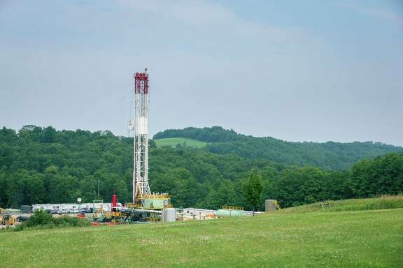 Southwestern Energy Co., which operates this Pennsylvania well, will pay Chesapeake Energy $5.4 billion for more acreage in that state and West Virginia.