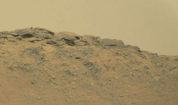 A man sitting on Mars?Can you see the sitting figure in this photo captured by a NASA rover? Photo: NASA