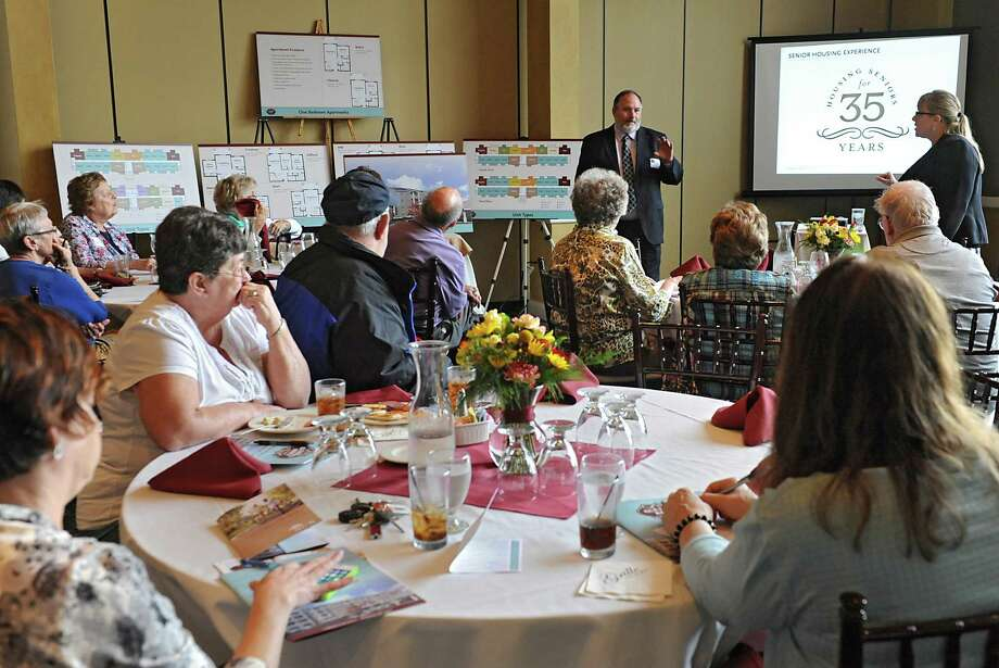 Tim Haskins and Sharon Kelley of United Group of Companies answers questions from potential clients of the proposed Glenmont Abbey Village which is an apartment community targeting residents 55 and over on Thursday, Oct. 16, 2014 in Delmar, N.Y. The informational luncheon took place at Normanside Country Club. (Lori Van Buren / Times Union) Photo: Lori Van Buren / 10028903A
