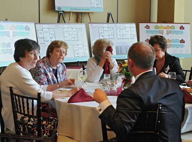 Michael Uccellini, president and CEO of United Group of Companies, talks to potential clients of the proposed Glenmont Abbey Village, an apartment community targeting residents 55 and over, during an informational luncheon at Normanside Country Club on Thursday, Oct. 16, 2014 in Delmar, N.Y.(Lori Van Buren / Times Union) Photo: Lori Van Buren / 10028903A