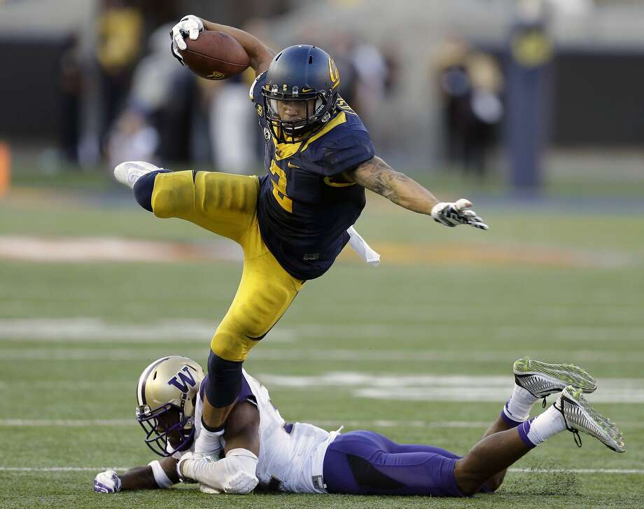 California's Daniel Lasco (2) tries to evade the grasp of Washington's Budda Baker during the second half of the Bears' loss to the Huskies in October. Photo: Ben Margot, Associated Press