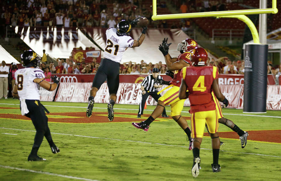 Arizona State's Jaelen Strong snares a 46-yard touchdown pass in front of two USC defenders to lift the Sun Devils on the final play Oct. 4. He leads the Pac-12 in reception yards per game. Photo: Rob Schumacher / Associated Press / DITThe Republic