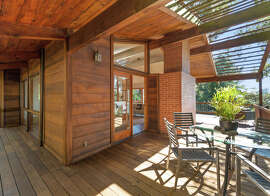 The partially covered deck off the living room  at 6441 Castle Drive in Montclair offers a place for outdoor dining.