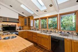 A commercial range and exhaust hood, skylights and display cabinets are inclusions of the kitchen.