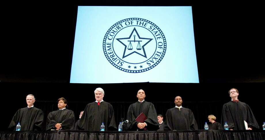 Texas Supreme Court Justices stand before the new members of the State Bar of Texas during induction ceremony at the Frank C. Erwin Center on the campus of The University of Texas at Austin, Monday, Nov. 22, 2010. (Billy Smith II/ Houston Chronicle) Photo: Billy Smith II, HC Staff / Houston Chronicle