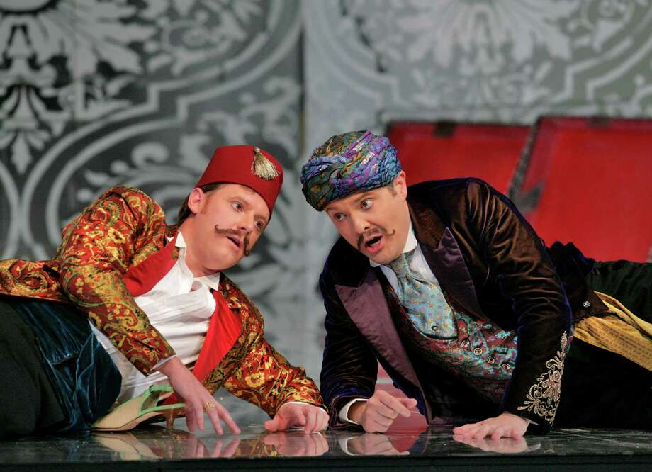 "Norman Reinhardt, left, and Mark Stone appear in the Santa Fe Opera's 2007 production of Wolfgang Mozart's ""Cosi fan tutte."" Photo: Ken Howard / handout"