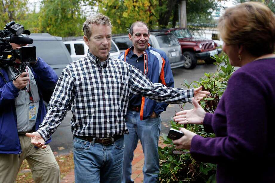 Sen. Rand Paul, R-Ky., is greeted by state GOP Chair Jennifer Horn at the party headquarters Thursday Oct. 16, 2014 in Concord, N.H. The possible 2016 Republican presidential candidate was in the nation's first presidential primary state to rally voters ahead of the November election. (AP Photo/Jim Cole) Photo: Jim Cole / Associated Press / AP
