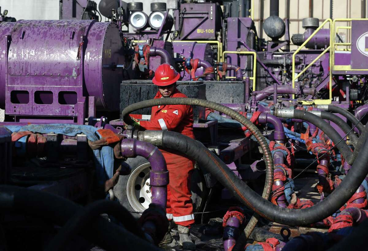A worker adjusts hoses for hydraulic fracturing near Mead, Colo. The government wants to expand a survey of U.S. oil output.