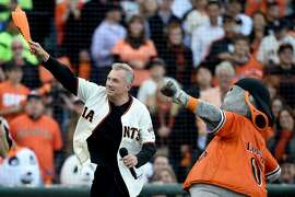 SAN FRANCISCO, CA - OCTOBER 16:  Former San Francisco 49ers quarterback Joe Montana pumps up the crowd along with mascot Lou Seal before the San Francisco Giants take on the St. Louis Cardinals during Game Five of the National League Championship Series at AT&T Park on October 16, 2014 in San Francisco, California.  (Photo by Thearon W. Henderson/Getty Images)