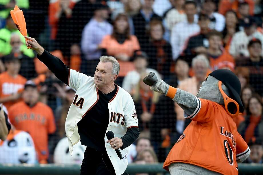SAN FRANCISCO, CA - OCTOBER 16:  Former San Francisco 49ers quarterback Joe Montana pumps up the crowd along with mascot Lou Seal before the San Francisco Giants take on the St. Louis Cardinals during Game Five of the National League Championship Series at AT&T Park on October 16, 2014 in San Francisco, California.  (Photo by Thearon W. Henderson/Getty Images) Photo: Thearon W. Henderson, Getty Images