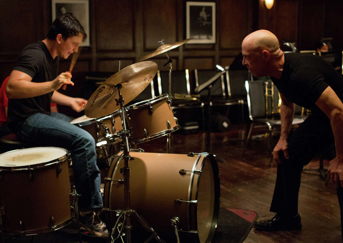 Miles Teller (left) plays a talented young dummer and J.K. Simmons portrays his sadistic teacher in the new drama
