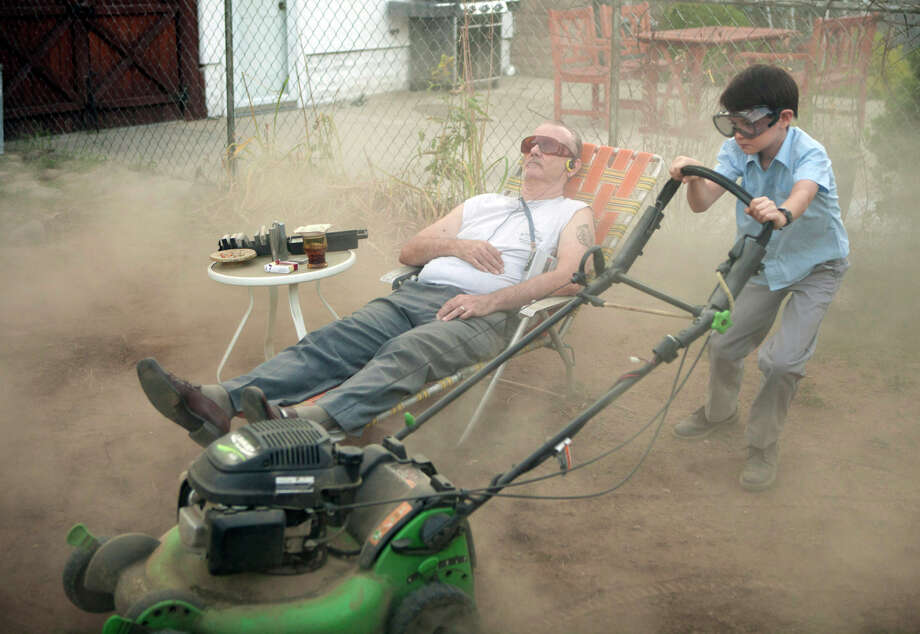 """Bill Murray gets young neighbor Jaeden Lieberher to mow his lawn in """"St. Vincent."""" Murray ends up looking after the boy, whose mother is played by Melissa McCarthy, after he gets bullied at school. Photo: Atsushi Nishijima / Associated Press / The Weinstein Company"""