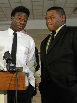 Karsiah Duncan, left, son of ebola patient Eric Duncan.