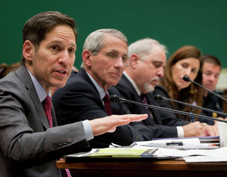 Centers for Disease Control and Prevention (CDC), Director Dr. Tom Frieden, far left, testifies as he sits on a panel with, from second from left,, Dr. Anthony Fauci, director of The National Institute of Allergy and Infectious Diseases, Dr. Robin Robinson, director of the Biomedical Advanced Research and Development Authority at the U.S. Department of Health and Human Service, Dr. Luciana Borio, assistant commissioner for counterterrorism policy at the U.S. Food and Drug Administration and John Wagner, the Acting assistant Commissioner at the Office of Field Operations for U.S. Customs and Border Protection, testify on Capitol Hill in Washington, Thursday, Oct. 16, 2014, before the House Energy and Commerce Committee's subcommittee on Oversight and Investigations hearing to examine the government's response to contain the disease and whether America's hospitals and health care workers are adequately prepared for Ebola patients. (AP Photo/Pablo Martinez Monsivais) Photo: Pablo Martinez Monsivais / Associated Press / AP