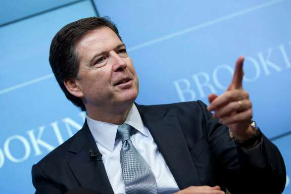 """FBI Director James Comey speaks about the impact of technology on law enforcement, Thursday, Oct. 16, 2014, at Brookings Institution in Washington. Comey gave a stark warning Thursday against smartphone data encryption, saying homicide cases could be stalled, suspects could go free and """"justice may be denied because of a locked phone or an encrypted hard drive.""""  (AP Photo/Jose Luis Magana)"""