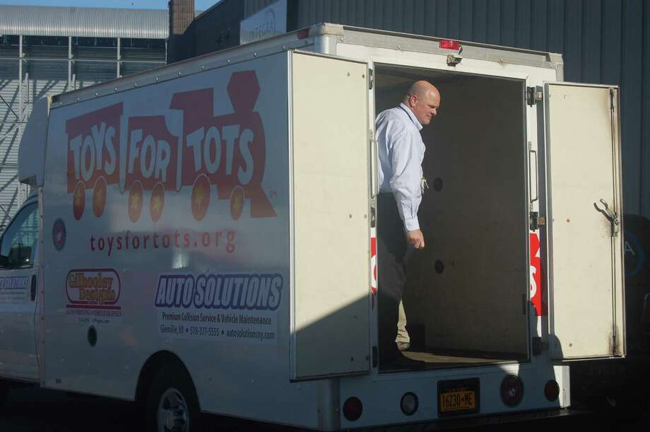IntegraOptics Dave Prescott, president of IntegraOptics, is ready to help load a Toys for Tots van in Colonie.
